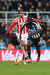 Stoke's Marc Muniesa brings down Moussa Sissoko of Newcastle United to earn a yellow card - Newcastle United vs. Stoke City - Barclay's Premier League - St James' Park - Newcastle - 08/02/2015 Pic Philip Oldham/Sportimage