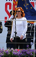May 26, 2017; Indianapolis, IN, USA; Country recording artist/actress Reba McEntire sings the national anthem prior to the Indy Lights Series Freedom 100 at Indianapolis Motor Speedway. Mandatory Credit: Mark J. Rebilas-USA TODAY Sports