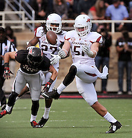 STAFF PHOTO BEN GOFF  @NWABenGoff -- 09/13/14 Arkansas linebacker Brooks Ellis (51) tries to hold onto the ball for an interception after breaking up a pass intended for Texas Tech receiver Jordan Davis, with Arkansas free safety Alan Turner looking on, during the second quarter of the game in Jones AT&T Stadium in Lubbock, Texas on Saturday September 13, 2014.