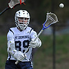 Tommy Rooney #89 of St. Dominic makes a pass during a varsity boys lacrosse game against Long Island Lutheran at Charles Wang Athletic Complex in East Norwich on Monday, April 30, 2018.