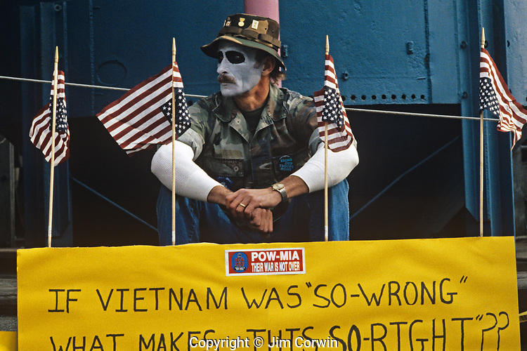 Vietnam Veteran protester at the Gas Works park in downtown Seattle sitting and holding a No War poster protesting the US involvement in Persian Gulf January 15 deadline 1991, Seattle Washington State USA