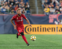 FOXBOROUGH, MA - AUGUST 31: Nick DeLeon #18 of Toronto FC dribbles at midfield during a game between Toronto FC and New England Revolution at Gillette Stadium on August 31, 2019 in Foxborough, Massachusetts.