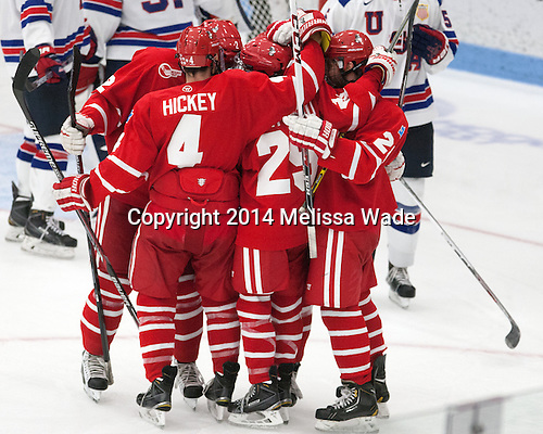 The Terriers celebrate Danny O'Regan's (BU - 10) goal. - The players being evaluated for the US Under-20 World Juniors team defeated the Boston University Terriers 5-2 (EN) on Friday, December 19, 2014, at Walter Brown Arena in Boston, Massachusetts.
