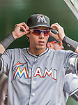 30 August 2015: Miami Marlins outfielder Christian Yelich adjusts his sun glasses in the dugout prior to facing the Washington Nationals at Nationals Park in Washington, DC. The Nationals defeated the Marlins 7-4 in the third game of their 3-game weekend series. Mandatory Credit: Ed Wolfstein Photo *** RAW (NEF) Image File Available ***