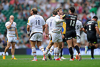 Elliot Daly of Wasps has a disagreement with Brad Barritt of Saracens during the Premiership Rugby Round 1 match between Saracens and Wasps at Twickenham Stadium on Saturday 6th September 2014 (Photo by Rob Munro)