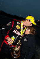 Aug 17, 2014; Brainerd, MN, USA; NHRA top fuel driver Morgan Lucas (left) kisses mother Charlotte Lucas as they celebrate after winning the Lucas Oil Nationals at Brainerd International Raceway. Mandatory Credit: Mark J. Rebilas-USA TODAY Sports