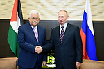 Russian President Vladimir Putin shakes hands with Palestinian President Mahmoud Abbas following a meeting at the Bocharov Ruchei state residence in Sochi, Russia, May 11, 2017. Photo by Thaer Ganaim