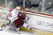Tommy Cross (BC - 4), Marc Concannon (UMass - 21) - The Boston College Eagles defeated the University of Massachusetts-Amherst Minutemen 2-1 (OT) on Friday, February 26, 2010, at Conte Forum in Chestnut Hill, Massachusetts.