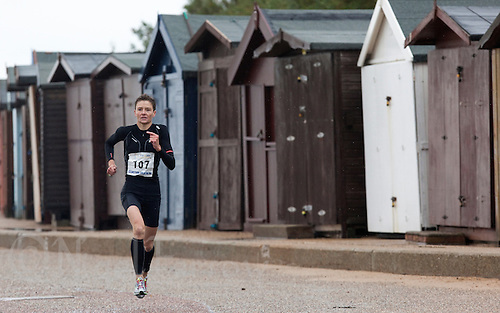 26 SEP 2010 - CLACTON, GBR - Loretta Sollars makes her way past the beach huts on the promenade during the Clacton Standard Distance Triathlon (PHOTO (C) NIGEL FARROW)