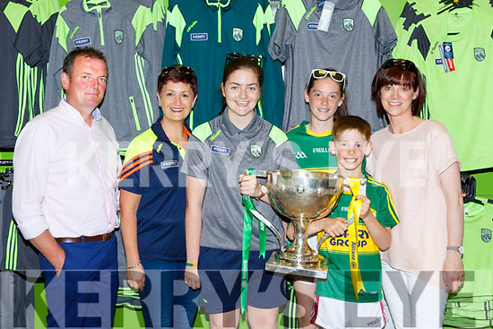 Danny, Debra, and Rcahel O'Connell, Shauna Adam and Joanne Tangney Scartaglen with the National League trophy at the Kerry GAA shop on Sunday
