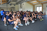 The Bath squad wait for a team meeting to start. Bath Rugby pre-season training on July 16, 2013 at Farleigh House in Bath, England. Photo by: Patrick Khachfe/Onside Images