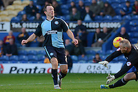 Wycombe Wanderers Garry Thompson clips the ball over Mansfield Town's goalkeeper Brian Jensen only to see his effort cleared off the goal line during the Sky Bet League 2 match between Mansfield Town and Wycombe Wanderers at the One Call Stadium, Mansfield, England on 31 October 2015. Photo by Garry Griffiths.