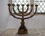 Brass candlestick holder six arms inside Holy Trinity church, Blythburgh, Suffolk, England, UK