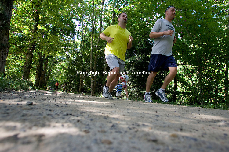 WASHINGTON, CT - 04 JULY 2010 -070410JT09-<br /> Runners approach the finish line of the Stephen Reich 5K Freedom Run at Steep Rock Reservation Horse Ring in Washington on Sunday. The run is in memory of Reich, a Washington native who was killed in action in Afghanistan in 2005.<br /> Josalee Thrift Republican-American