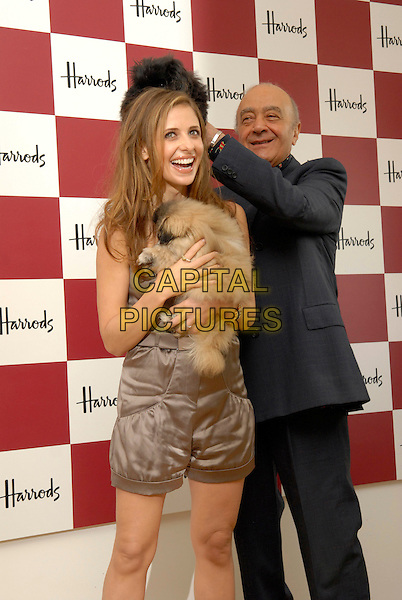 SARAH MICHELLE GELLAR & MOHAMMED AL FAYED .Open the Harrods Summer Sale, Harrods, Knightsbridge, London, England, July 2nd 2007..half length brown bronze strapless playsuit funny dogs animals on head playing.CAP/FIN.©Steve Finn/Capital Pictures.