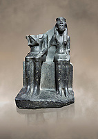 Ancient Egyptian statue of king Horemheb & his wife Mutnedjemet, granodiorite, New Kingdom, 18th Dynasty, (1319-1292 BC), Karnak, Temple of Amon. Egyptian Museum, Turin. Grey Background.<br /> <br /> Queen Mutnedjemet is depicted in the role of Hathor, the sun god, embracing her husband. The statue is unfinished with details missing including the stripes in the Royal kilt, the wings of a vulture on the queens headdress and bound enemies on one side of the throne. On the back of the throne is a long inscription recording the coronation of Horemheb who was the general of Tutenkhamun before ascending to the throne. Drovetto collection. C 1379.