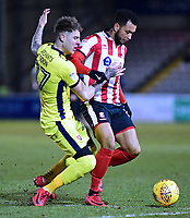 Lincoln City's Matt Green vies for possession with  Cheltenham Town's Joe Rodon<br /> <br /> Photographer Andrew Vaughan/CameraSport<br /> <br /> The EFL Sky Bet League Two - Lincoln City v Cheltenham Town - Tuesday 13th February 2018 - Sincil Bank - Lincoln<br /> <br /> World Copyright &copy; 2018 CameraSport. All rights reserved. 43 Linden Ave. Countesthorpe. Leicester. England. LE8 5PG - Tel: +44 (0) 116 277 4147 - admin@camerasport.com - www.camerasport.com