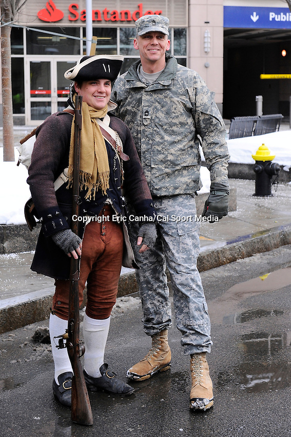 February 4, 2015 - Boston, Massachusetts, U.S. -  A Minuteman poses with a soldier prior to a parade held in Boston to celebrate the New England Patriots victory over the Seattle Seahawks in Super Bowl XLIX. Eric Canha/CSM