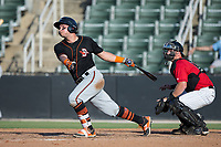 Daniel Fajardo (14) of the Delmarva Shorebirds follows through on his swing against the Kannapolis Intimidators at Kannapolis Intimidators Stadium on July 2, 2017 in Kannapolis, North Carolina.  The Shorebirds defeated the Intimidators 5-4.  (Brian Westerholt/Four Seam Images)