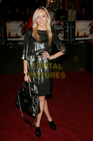 """NOELLE RENO.UK Premiere of """"Elizabeth - The Golden Age"""" at the Odeon Leicester Square, London, England, October 23rd 2007..full length black gold metallic shiny dress bag shoes boots hand on hip.CAP/AH.©Adam Houghton/Capital Pictures."""