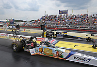 May 10, 2013; Commerce, GA, USA: NHRA top fuel dragster driver Brandon Bernstein (near lane) races alongside David Grubnic during qualifying for the Southern Nationals at Atlanta Dragway. Mandatory Credit: Mark J. Rebilas-