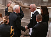 United States Vice President Mike Pence, left, shakes hands with former US Vice President Joe Biden, right, prior to the start of the National funeral service in honor of the late former United States President George H.W. Bush at the Washington National Cathedral in Washington, DC on Wednesday, December 5, 2018.<br /> Credit: Ron Sachs / CNP<br /> (RESTRICTION: NO New York or New Jersey Newspapers or newspapers within a 75 mile radius of New York City)