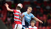 Blackpool's Brad Potts vies for possession with Doncaster Rovers' Joe Wright<br /> <br /> Photographer Chris Vaughan/CameraSport<br /> <br /> The EFL Sky Bet League Two - Doncaster Rovers v Blackpool - Keepmoat Stadium - Doncaster<br /> <br /> World Copyright &copy; 2017 CameraSport. All rights reserved. 43 Linden Ave. Countesthorpe. Leicester. England. LE8 5PG - Tel: +44 (0) 116 277 4147 - admin@camerasport.com - www.camerasport.com