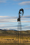Fairbank-Morse Eclipse steel windmill, clouds and hills in winter, Toyabe Range, Nevada
