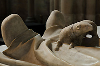 Ermine, at the feet of the effigy of Philip, 1396-1420, comte de Vertus, made 1504, on the funerary monument of the Dukes of Orleans, marble, 16th century, with effigies of Louis, Duke of Orleans, 1372-1407, Valentine Visconti his wife, 1366-1408, and their sons Charles the Poet, 1394-1465, and Philip, 1396-1420, comte de Vertus, in the Chapelle Saint-Michel, in the Basilique Saint-Denis, Paris, France. Statuettes of 24 saints and apostles stand in niches around the tomb, which was commissioned in 1502 by Louis XII and made by Italian artists. This tomb was originally in the Chapelle des Celestins in Paris. The basilica is a large medieval 12th century Gothic abbey church and burial site of French kings from 10th - 18th centuries. Picture by Manuel Cohen
