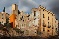 The Castle of Sant Joan or La Suda, above the derelict buildings of the old town or Casc Antic of Tortosa, Tarragona, Spain. The 10th century Castle of Sant Joan was built by Muslim Caliph Abd ar-Rahman III. It was conquered in 1148 and became residence of the Montcada and Knights Templar, then a royal mansion from the 13th century. Tortosa is an ancient town situated on the Ebro Delta which has a rich heritage dating from Roman times. Picture by Manuel Cohen