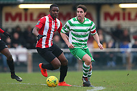 Olumide Oluwatimilehin of Hornchurch and Billy Holland of Waltham Abbey during AFC Hornchurch vs Waltham Abbey, Bostik League Division 1 North Football at Hornchurch Stadium on 13th January 2018