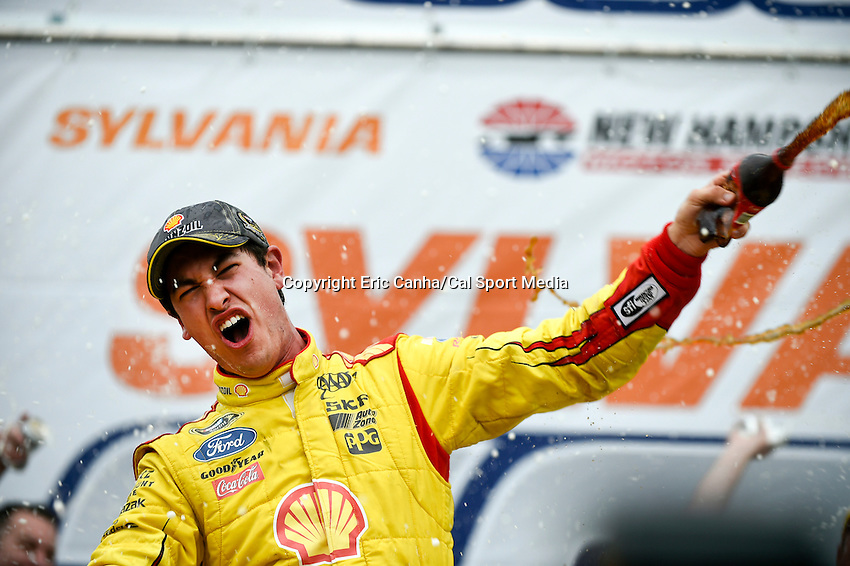 September 21, 2014 - Loudon, New Hampshire, U.S. - Sprint Cup Series driver Joey Logano (22) celebrates his victory at the Nascar Sprint Cup Series Sylvania 300 race held at the New Hampshire Motor Speedway in Loudon, New Hampshire.   Eric Canha/CSM