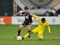 D.C. United defender Dejan Jakovic (5) goes against forward Jairo Arriteta (25) D.C. United defeated The Columbus Crew 3-2 at RFK Stadium, Saturday October 20, 2012.