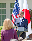 United States President Barack Obama listens to a reporter's question as he conducts a joint press conference with Prime Minister Shinzo Abe of Japan in the Rose Garden of the White House in Washington, D.C. on Tuesday, April 28, 2015.<br /> Credit: Ron Sachs / CNP