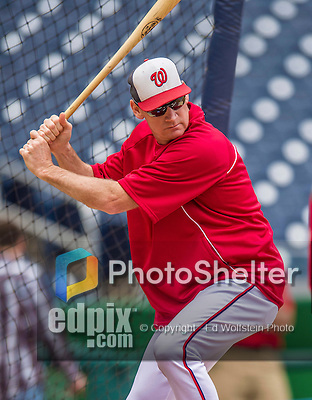 21 May 2014: Washington Nationals Manager Matt Williams hits outfield flies to warm up outfielders prior to a game between the Cincinnati Reds and the Washington Nationals at Nationals Park in Washington, DC. The Reds edged out the Nationals 2-1 to take the rubber match of their 3-game series. Mandatory Credit: Ed Wolfstein Photo *** RAW (NEF) Image File Available ***