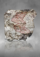 Geometric wall painting fragment found in 1999 in building 2, space 117, level IX. Unit no 4223X1. Catalhoyuk collection, Konya Archaeological Museum, Turkey. Against a grey background