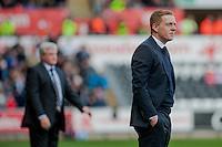 SWANSEA, WALES - APRIL 04:Manager of Swansea City, Garry Monk looks on  during the Premier League match between Swansea City and Hull City at Liberty Stadium on April 04, 2015 in Swansea, Wales.  (photo by Athena Pictures)
