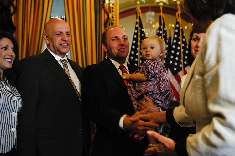 WASHINGTON, DC - May 07: Rep. Steve Scalise, R-La., during a mock swearing in for the cameras with his sister, Tara Scalise (far left), father Al Scalise, wife Jennifer, daughter Madison, and House Speaker Nancy Pelosi, D-Calif., after he was sworn in on the House floor. During his official swearing in, he held his 13-month-old daughter Madison in his arms, and took the oath of office Wednesday as the House's newest and 434th member. Scalise handily won a special election March 1 in Louisiana's 1st District, providing Republicans with a rare bright spot in a year of electoral setbacks. He takes the seat vacated by former Rep. Bobby Jindal, a fellow Republican who was elected Louisiana governor late last year. The 42-year-old computer science graduate from Louisiana State University and veteran of a dozen years in his state's legislature used his first remarks in the well of the House to thank Congress for the billions of dollars in hurricane recovery funds it has sent to Louisiana. ( Photo by Scott J. Ferrell/Congressional Quarterly)