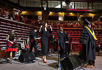 NWA Democrat-Gazette/BEN GOFF @NWABENGOFF<br /> The University of Arkansas Soul Band performs 'I'll Take You There' to honor the song's writer Al Bell (not pictured) Saturday, May 11, 2019, during the University of Arkansas all university commencement ceremony in Bud Walton Arena in Fayetteville. An award-winning songwriter and record producer from Arkansas, Bell was presented an honorary degree during the commencement.