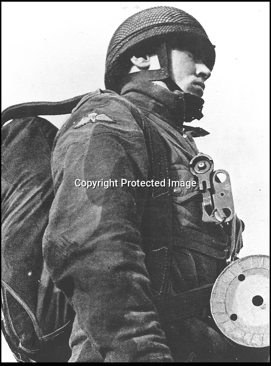 BNPS.co.uk (01202 558833).Pic: StewartWardrope/BNPS..***Please use full byline***..Paratrooper complete with trusty pigeon....Valuable bravery medals awarded to a flock of wartime homing pigeons have come to light to reveal the ingenious ways the British went about spying on the enemy...The birds were strapped in mini-parachutes and placed in small crates that were dropped behind enemy lines in order for the French Resistance to use...A corkscrew fan on the wooden crate unwound in the wind leading to the door to open.automatically in mid-air, allowing the pigeon to drop to the ground...The French attached coded messages about German military movements to the birds which flew across the English Channel with the precious intelligence...But one chilling note that has emerged after 70 years was written in German and informed the British the French recipient had been shot for spying having been found with a pigeon...Some 32 racing pigeons were awarded the prestigious Dickin Medal - the animal version of the Victoria Cross - for their acts of heroism in World War Two...The Royal Pigeon Racing Association owns five of them. Its general manager, Stewart Wardrope, took them along to the BBC's Antiques Roadshow to show them off...He also revealed the stories behind their award as well some of the other madcap inventions made by British boffins and used to gather intelligence using the birds...These included a clockwork camera strapped to the belly of a pigeon that automatically took reconaissance snaps of Nazi-occupied Europe before returning home...Of the five medals due to be featured on this Sunday's Antiques Roadshow, two were awarded to pigeons that delivered important intelligence from Europe six times between them...Another, named 'Beachcomber', brought back the first news of the disastrous landings at Dieppe in September 1942.