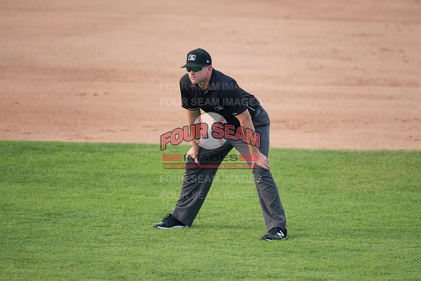 Field umpire Pete Talkington during a Pioneer League game between the Missoula Osprey and the Orem Owlz at Ogren Park Allegiance Field on August 19, 2018 in Missoula, Montana. The Missoula Osprey defeated the Orem Owlz by a score of 8-0. (Zachary Lucy/Four Seam Images)