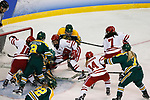 ST CHARLES, MO - MARCH 19:  Players from Wisconsin Badgers scramble for the puck in from to the Clarkson Golden Knights goal during the Division I Women's Ice Hockey Championship held at The Family Arena on March 19, 2017 in St Charles, Missouri. Clarkson defeated Wisconsin 3-0 to win the national championship. (Photo by Mark Buckner/NCAA Photos via Getty Images)