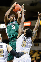 December 7, 2013 - Orlando, FL, U.S: Stetson forward Willie Green (3) takes a shot over Central Florida forward Eugene McCrory (5) during 1st half mens NCAA basketball game action between the Stetson Hatters and the UCF Knights at the CFE Arena in Orlando, Fl.