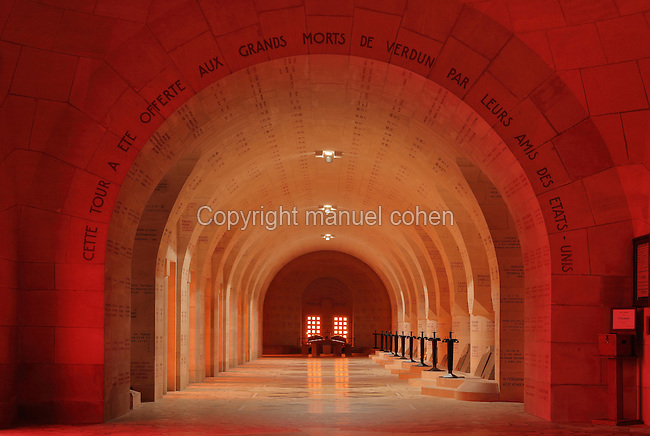 Interior and cloister of the Ossuaire de Douaumont or Douaumont Ossuary, designed by Leon Azema, Max Edrei and Jacques Hardy, inaugurated 7th August 1932 by French President Albert Lebrun, to house the remains of French and German soldiers who died at the Battle of Verdun in World War One, at Douaumont, Verdun, Meuse, Lorraine, France. The ossuary contains the remains of over 130,000 soldiers, some of whom are named on the plaques covering the walls and ceiling. The adjoining military cemetery holds 16,142 graves and is the largest single French military cemetery of the First World War, inaugurated in 1923 by Verdun veteran Andre Maginot. It has been listed as a national cemetery. Picture by Manuel Cohen