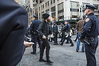 NEW YORK,NY APRIL 14: Police blocking the road to stop some people who tried to cross the street around the Hyatt Hotel during  the anti-Trump protest in midtown Manhattan on April 14,2016 in New York City.Photo by VIEWpress/Maite H. Mateo