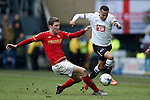Forest?s Gary Gardener tackles Marcus Olsson of Derby during the Skybet Championship match at the iPro Stadium. Photo credit should read: Philip Oldham/Sportimage