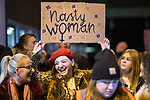 """© Joel Goodman - 07973 332324 . 22/02/2018 . Manchester , UK . A woman holds a """" Nasty Woman """" placard in the crowd . 100s of protesters , campaigning against the sexual harassment, abuse, rape and victim-blaming suffered by women, hold a Reclaim the Night march and rally from Owens Park in Fallowfield to the Manchester Academy on Oxford Road . Photo credit : Joel Goodman"""