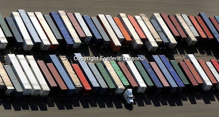 Containers lined up like dominoes at the Oakland shipyard, California.