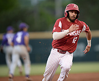 NWA Democrat-Gazette/ANDY SHUPE<br /> Arkansas catcher Casey Opitz heads to the plate Friday, May 10, 2019, on a double by left fielder Christian Franklin during the third inning against LSU at Baum-Walker Stadium in Fayetteville. Visit nwadg.com/photos to see more photographs from the game.