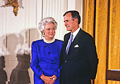 United States President George H.W. Bush and first lady Barbara Bush present the National Medal of Arts during a ceremony in the East Room of the White House in Washington, DC on November 19, 1989. <br /> Credit: Ron Sachs / CNP